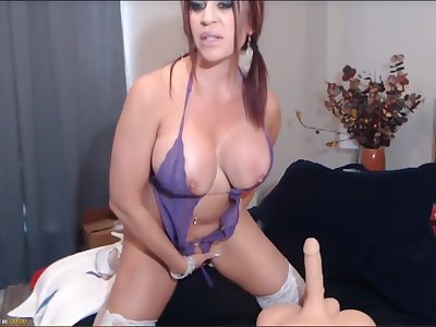 Hot of age wed with overheated hair, is sucking a big fake dick and toying will not hear of pussy.