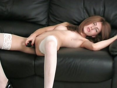 Skinny brunette Freya enjoys drilling her wet pussy with a dildo