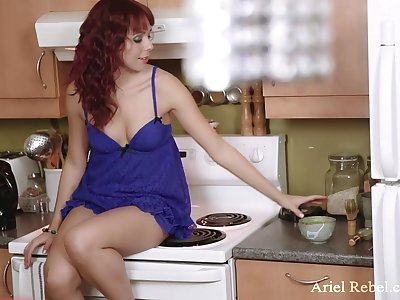 Ariel Rebel is relating to the kitchen making breakfast and masturbating