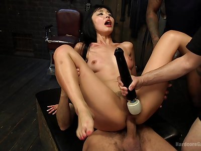 Asian slut takes merging dicks up their way ass together with pussy